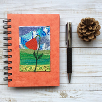 Embroidered poppy A6 lined notebook.