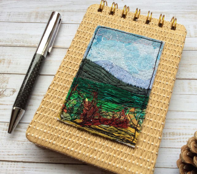 Embroidered landscape A6 raffia reporters notepad.