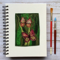 Embroidered butterfly sketchbook, scrapbook or journal.