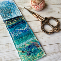 Up-cycled embroidered seascape bookmark.