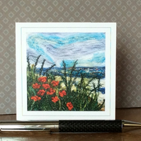 Embroidered seascape with poppies card.