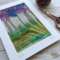 Embroidered up-cycled landscape.
