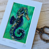 Embroidered up-cycled seahorse.