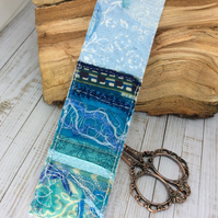 Upcycled embroidered seascape bookmark.