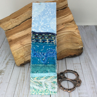 Embroidered up-cycled seascape bookmark.