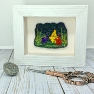 Embroidered flowers, plants and wall art work.