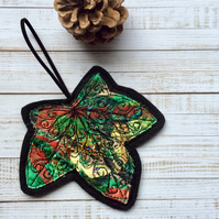Embroidered up-cycled leaf home decoration.