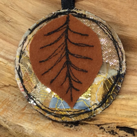 Up-cycled embroidered leaf necklace or pendant.
