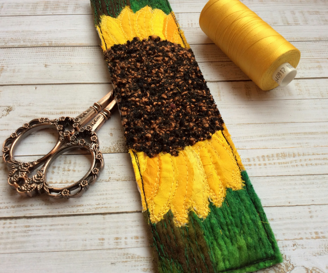 Embroidered up-cycled sunflower bookmark.