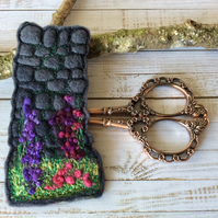 Embroidered wall and flower bookmark.
