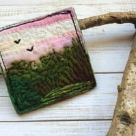 Embroidered sunset landscape brooch pin of badge.