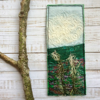 Embroidered up-cycled landscape bookmark.
