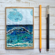 A5 embroidered up-cycled seascape sketchbook, journal or scrap book.