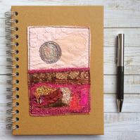 A5 embroidered up-cycled landscape hard backed lined notebook.