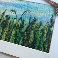 Felted hedgerow embroidered landscape.