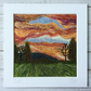 Embroidered sunset needle felted countryside landscape.
