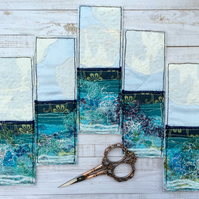 Embroidered upcycled seascape bookmark.