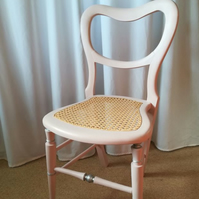 Antique chair in pale pink chalk paint.