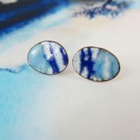 Oval copper and silver stud earrings with turquoise, blue and white enamel