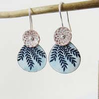 Two enamel on copper disc dangles with textured pattern and leaf design