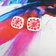 Square enamel studs with hand sewn pink thread detail