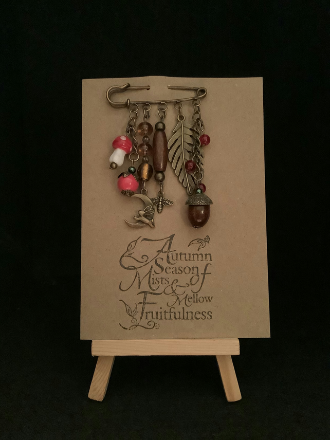 Handmade Autumn themed kilt pin brooch attached to a kraft greetings card.