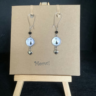 Handmade drop earrings with cabochon, Tibetan silver charm and beads.