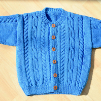 hand knitted baby cardigan with aran style pattern to fit age 1 to 2 years