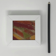 Harris Tweed textile art (red, range, yellow, green)