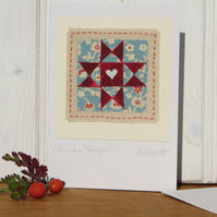 Christmas Patchwork, miniature hand-stitched textile on card, with tiny heart