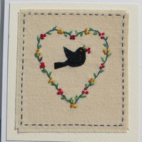 Hand-embroidered heart berry wreath with blackbird entitled 'Christmas Dinner!'