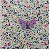 Butterfly Garden hand-stitched embroidery inspired by nature, intricate,detailed