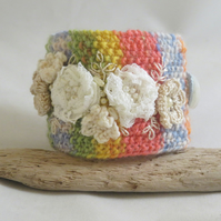 Lace flowers on a rainbow background cuff