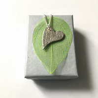 Heart shape pendant imprinted with a Mint leaf