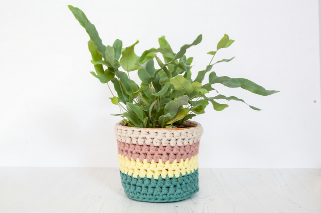 Medium plant pot cover in stripes. Made from recycled cotton.