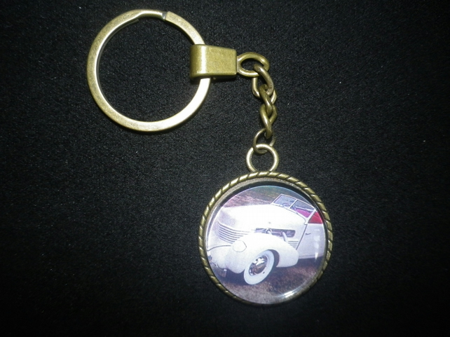 "1937 Cord Cabriolet keychain,lovely shape,30mm (1.25"") image,vintage setting"
