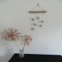 Upcycled wire flower wall hanging