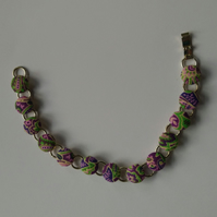 SALE - Green and Purple Design Fabric Covered Button Bracelet