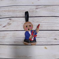 Guitarist gingerbread man decoration also  available as  keyring, fridge magnet