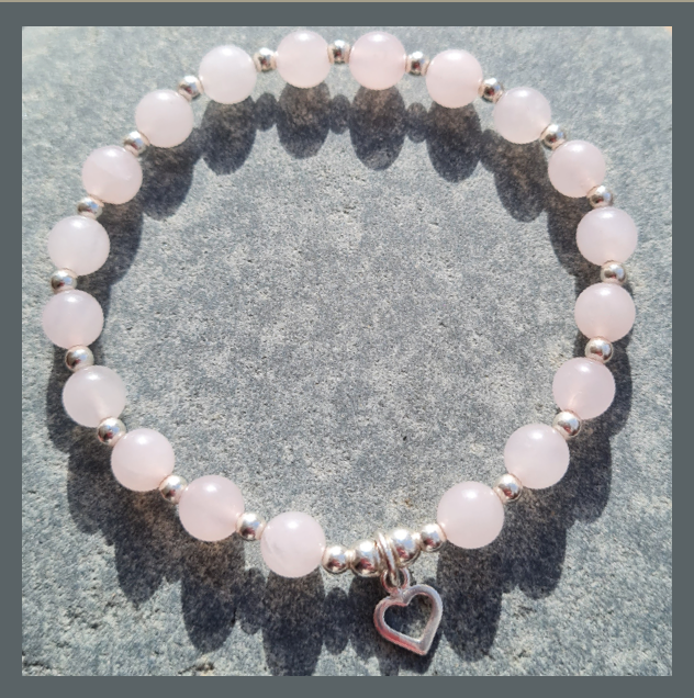 Rose Quartz and Sterling Silver beaded Bracelet with Heart Charm.