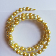 Yellow and cream Swarovski pearl bracelet on memory wire