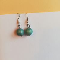 Shiny blue wooden bead earrings