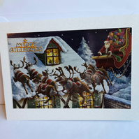 Santa on his sleigh Christmas card