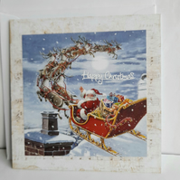 Handmade Christmas card showing Santa on slieigh
