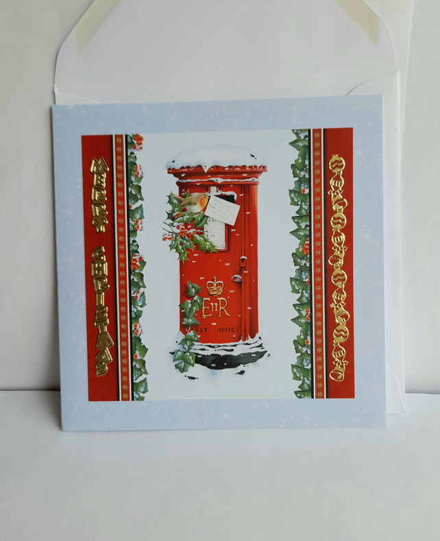 Handmade Christmas card showing a robin posting a letter