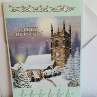 Christmas card showing snowy church scene