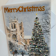 Christmas card showing church and Xmas tree in the snow
