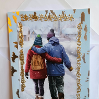 Christmas card showing backpackers in the snow