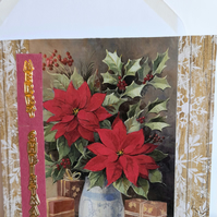 Christmas card showing poinsettias