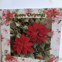 Christmas card showing poinsettia and holly